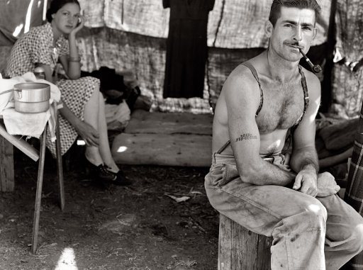 "Oregon, August 1939. ""Unemployed lumber worker goes with his wife to the bean harvest. Note Social Security number tattooed on his arm."" (And now a bit of Shorpy scholarship/detective work. A public records search shows that 535-07-5248 belonged to one Thomas Cave, born July 1912, died in 1980 in Portland. Which would make him 27 years old when this picture was taken.)"