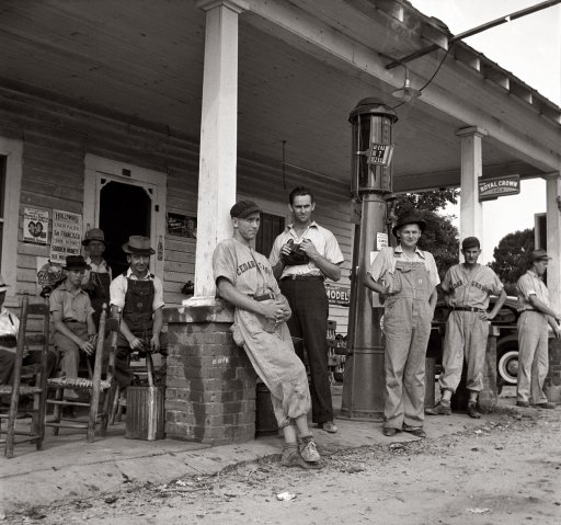Fourth of July 1939 near Chapel Hill, North Carolina. Rural filling stations become community centers and general loafing grounds. Cedargrove Team members about to play in a baseball game.